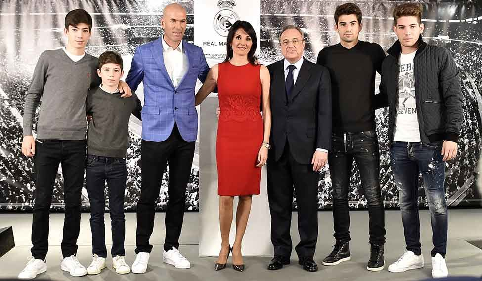 Support system zidane with wife veronique centre their four sons and real madrids president florentino perez third from right afp