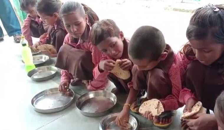 UP: Journalist booked for 'expose' on roti, salt midday meal