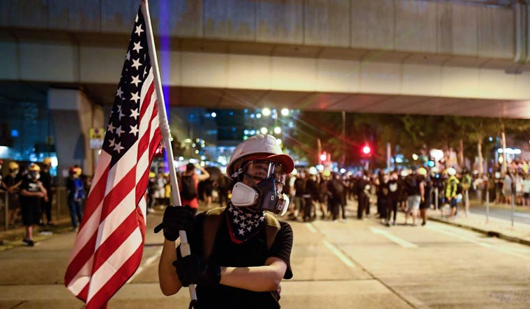 Hong Kong protesters wave American flag, sing national anthem